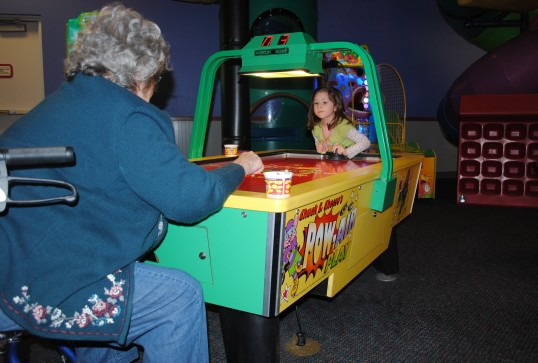 Playing Air Hockey  with Grandma @ Chucky Cheese