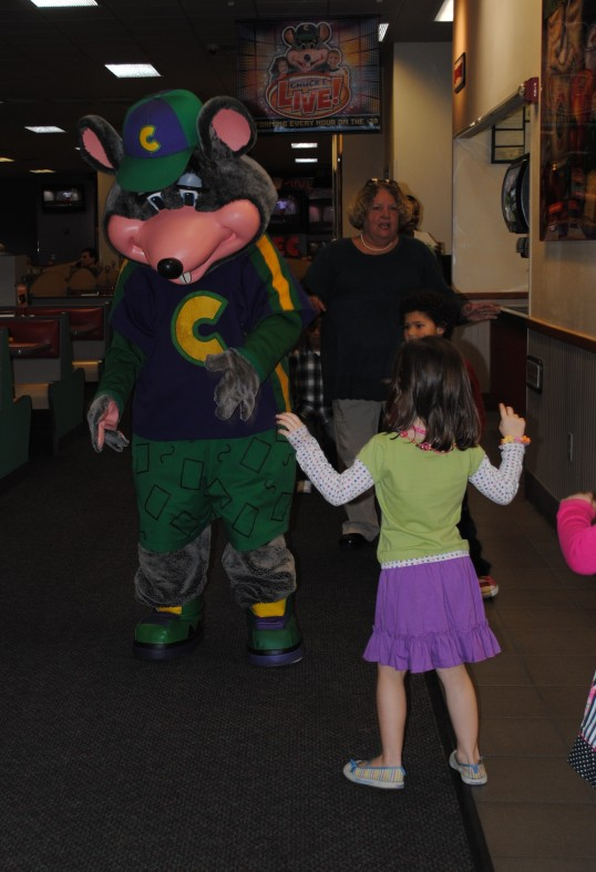 She's giving her big monster roar to Chucky Cheese