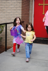 The girls racing at the beginning of their Easter Egg hunt