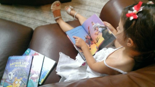 "Reading ""Up"" and other books she just got at the Library"