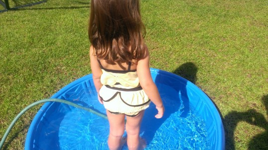 Can you see the little wings on her Bee swimsuit?