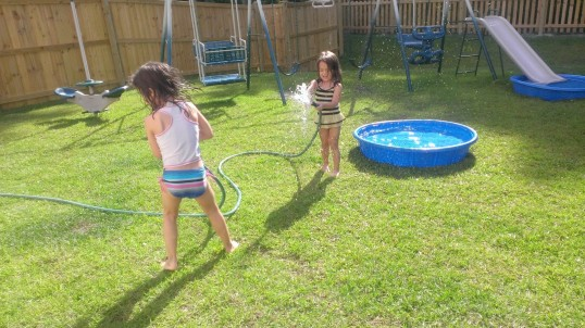 Yes, Chum leaped over both pools in one giant stretch, but not while the girls had the hose out