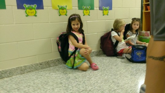 Waiting in line at her new class room