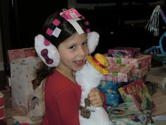 """Hello Kitty ear muffs and Olaf talking snowman, oh yea"""