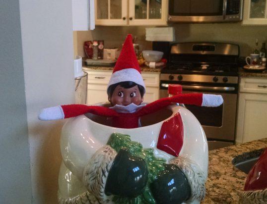 Elf Lana pretending she's a snowman